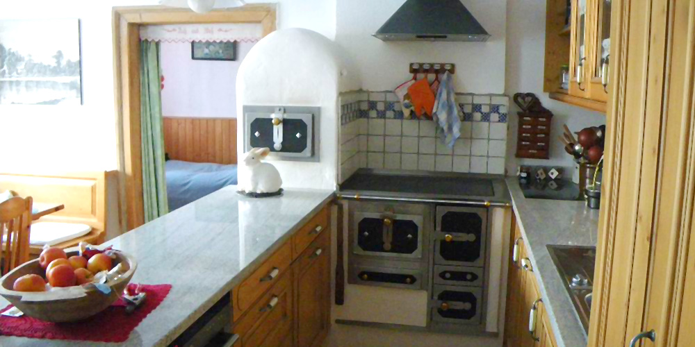 Küchenherd mit Lehmaufsatzteil